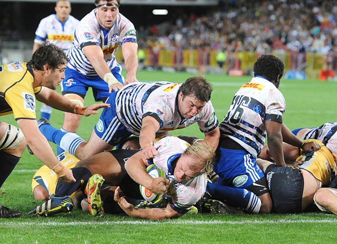 CAPE TOWN, SOUTH AFRICA - MAY 09: Schalk Burger of the Stormers  dives over for a try during the Super Rugby match between DHL Stormers and Brumbies at DHL Newlands Stadium on May 09, 2015 in Cape Town, South Africa. (Photo by Peter Heeger/Gallo Images)