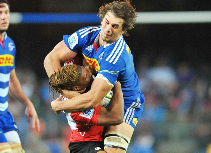 CAPE TOWN, SOUTH AFRICA - JUNE 06: Eben Etzebeth of the Stormers tackles Howard Mnisi of the Lions during the Super Rugby match between DHL Stormers and Emirates Lions at DHL Newlands Stadium on June 06, 2015 in Cape Town, South Africa. (Photo by Ashley Vlotman/Gallo Images)
